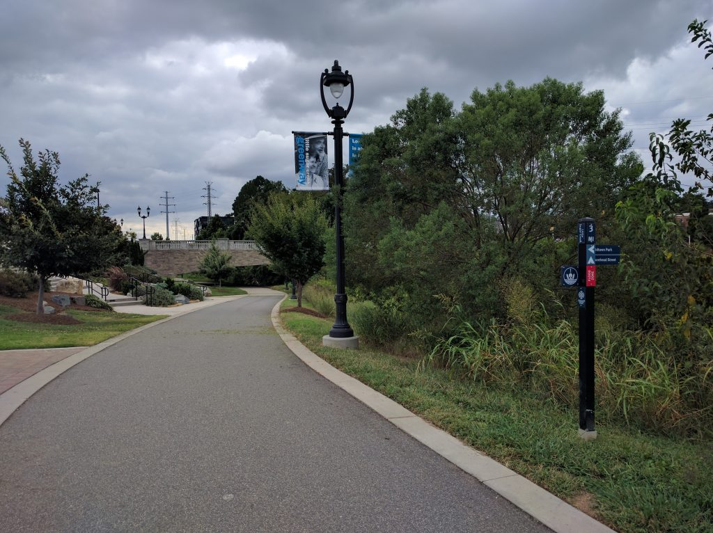 The Midtown Urban Greenway was the site of a former mall that covered up a section of Little Sugar Creek. Storm Water Services used $40 million for a daylighting and stream restoration project after buying out many of the businesses that had been built on top of the creek. Working with at least a dozen other agencies, Storm Water Services was able to engage with both the public and private sector to create this tremendous community asset. Photo by Ashton Rohmer