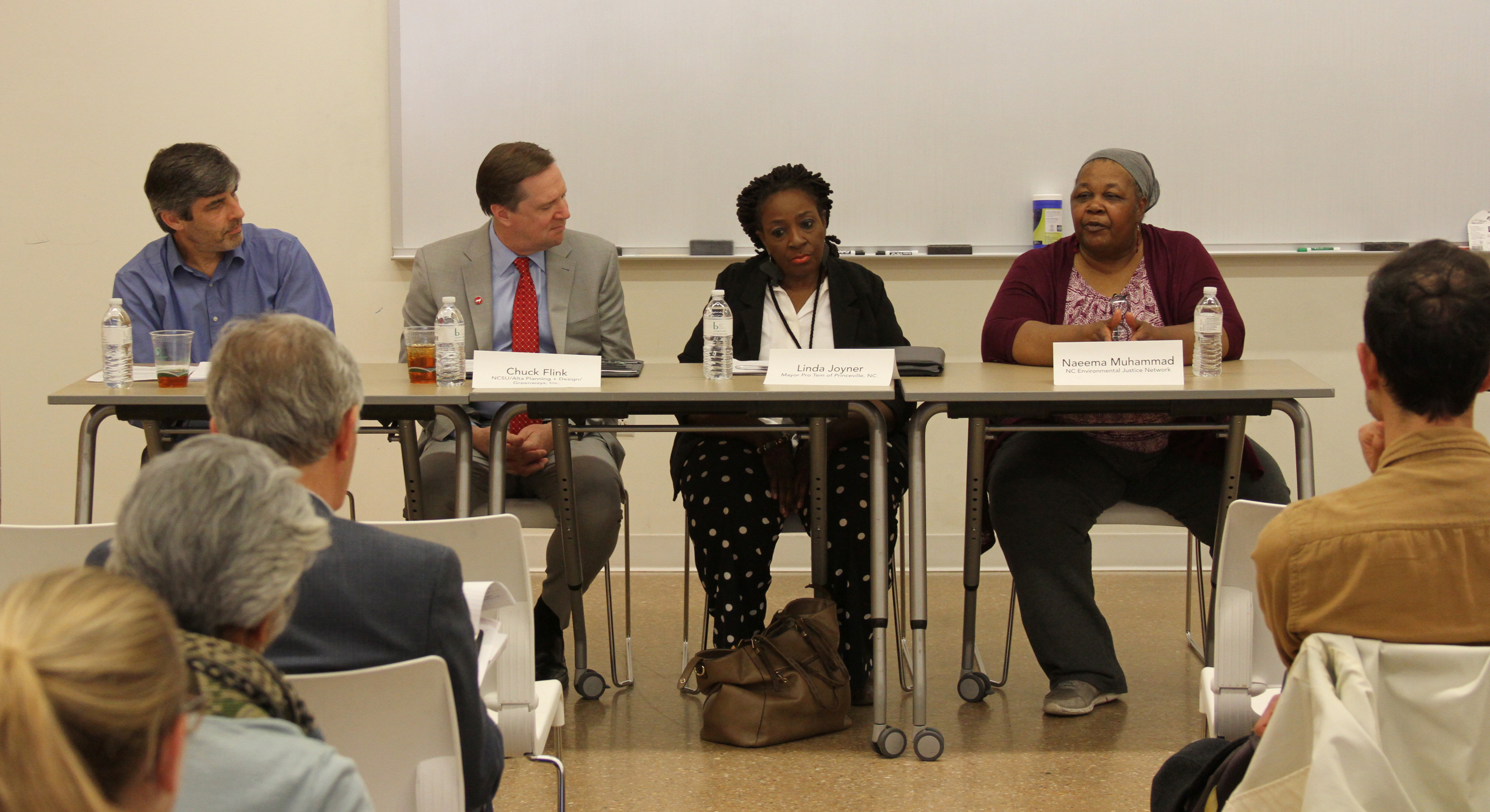 """Naeema Muhammad,organizing co-director of North Carolina Environmental Justice Network (third from right) speaks on the """"Rural Disaster Recovery and Hurricane Matthew"""" panel at the Climate Change and Resilience Symposium on April 20, 2018. The panel also included (from left) Dr. Larry Engel,professor in the UNC Department of Epidemiology; Chuck Flink,professor in Landscape Architecture at NC State University; and Linda Joyner,Mayor Pro Tem of Princeville, N.C."""