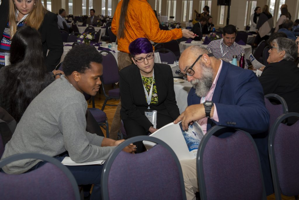 From left: CRC students Alex Halloway of UNC-Chapel Hill and Sarah Lipuma of Duke University discuss presentations with Cecilio Ortiz García, Senior RISE Fellow with the National Council for Science and the Environment. Photo By Brian Busher, University of Albany