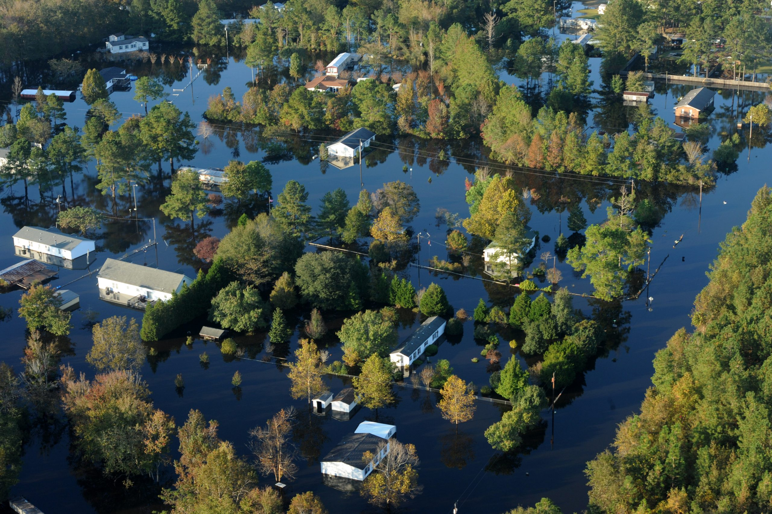 Floodwaters from Hurricane Matthew (2016) surround many houses in Craven County, N.C. Photo by Jocelyn Augustino/FEMA.