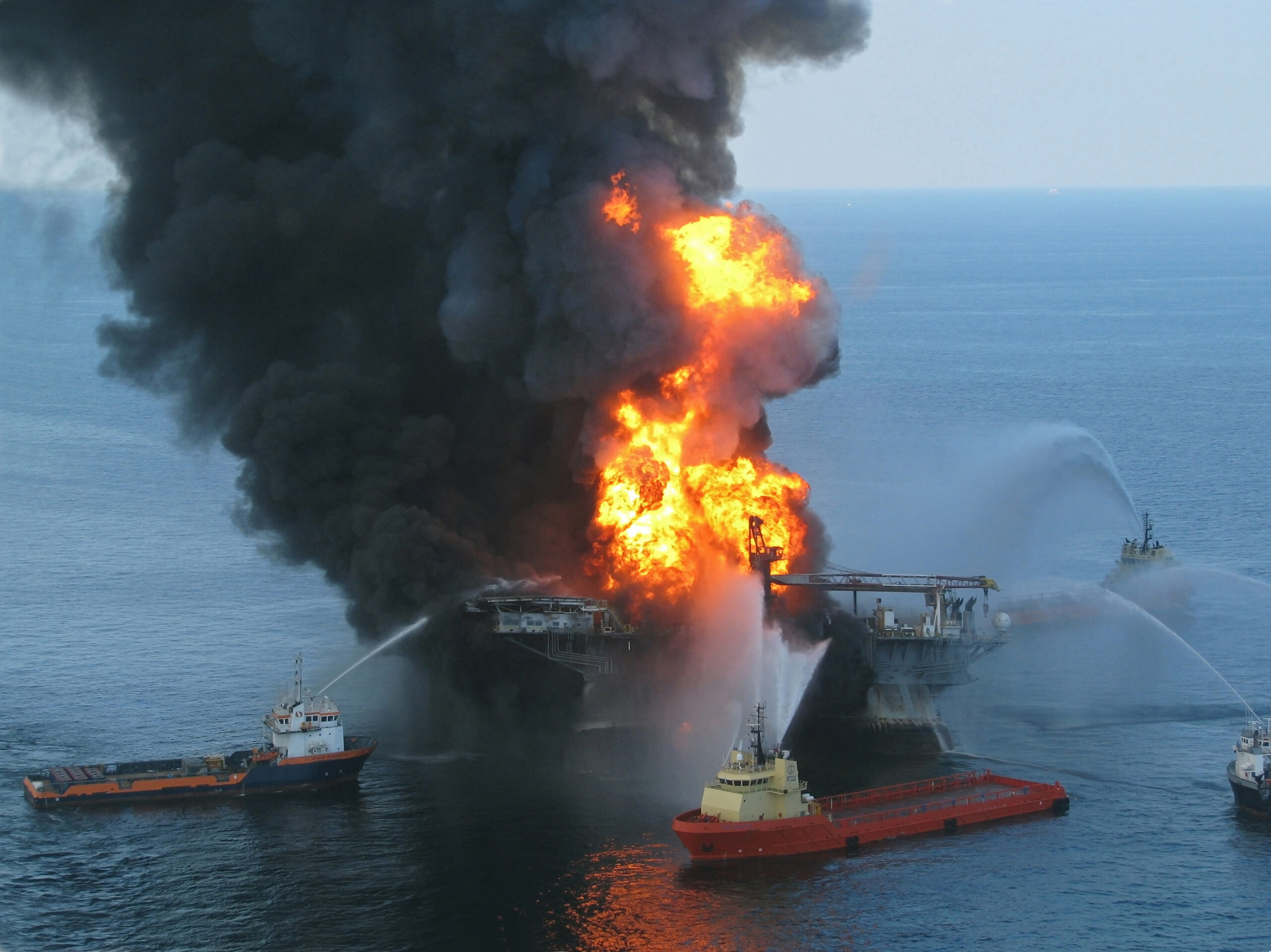 Anchor handling tugs and platform supply vessels combat the fire on the Deepwater Horizon while the U.S. Coast Guard searches for missing crew. Photo via Wikipedia.